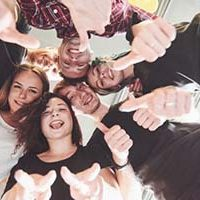happy-group-friends-with-their-hands-together-middle_146671-15292