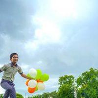 little-indian-school-boy-jumping-sky-with-tri-color-balloons-celebrating-independence-republic-day-india_54391-2254