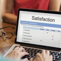 online-satisfaction-rating-laptop_53876-94855