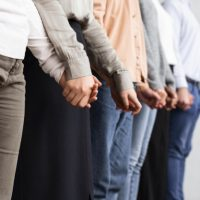 people-holding-hands-group-therapy-session_23-2148752045
