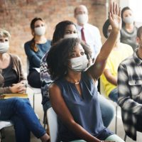 people-wearing-mask-during-workshop-new-normal_53876-96199