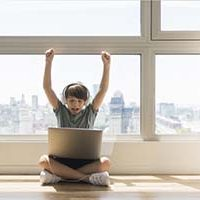 young-boy-playing-laptop_23-2148492903